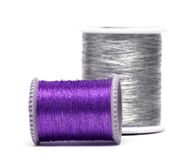Violet and silver spools Stock Photography