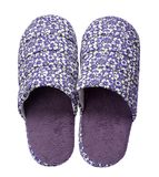 Violet slippers with flower print isolated on white background. Close up, high resolution Royalty Free Stock Photo