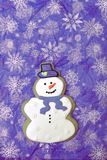 Violet snowman cookie. Snowman certical photo flat. Free space Stock Photos