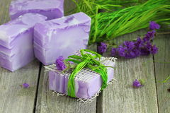 Violet soap. Colored handmade soaps with herbs stock images