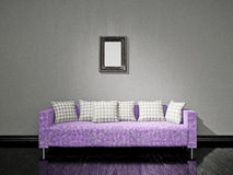 Violet sofa near the wall. Violet sofa with pillows near the old wall Stock Image