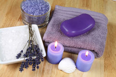 Violet spa therapy. Spa resort therapy composition - lavender flowers, candles and salt crystals. Afternoon relax Stock Image