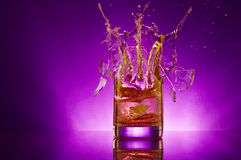 Violet splash. View of splintered glass with small pieces  are flying away Stock Image