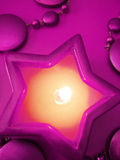 Violet star candle Royalty Free Stock Images