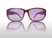 Violet sunglasses. On the white back Royalty Free Stock Photography