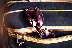 Violet sunglasses in the pocket of big Handbags Royalty Free Stock Photography