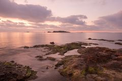 A violet sunrise on the beach of Ses figueretes, Ibiza. Spain Royalty Free Stock Images