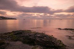A violet sunrise on the beach of Ses figueretes, Ibiza. Spain Stock Photography