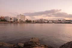 A violet sunrise on the beach of Ses figueretes, Ibiza. Spain Stock Image