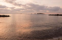 A violet sunrise on the beach of Ses figueretes, Ibiza. Spain Royalty Free Stock Photos
