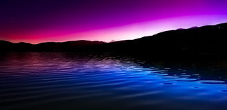 Violet sunrize. Highlands lake view during sunrise Royalty Free Stock Photography
