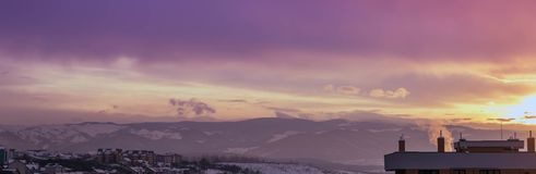 Violet sunset in the neighborhood. With the Carpathian mountains in the background Stock Images