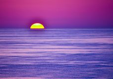 Violet Sunset Over the Gulf. Water royalty free stock photo