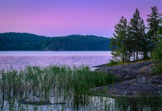 Violet sunset over lake Stock Photography