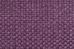Violet textile background with checkered pattern, closeup. Structure of the fabric macro. Stock Images