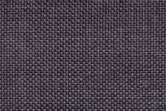 Violet textile background with checkered pattern, closeup. Structure of the fabric macro. Royalty Free Stock Photo