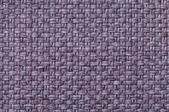 Violet textile background with checkered pattern, closeup. Structure of the fabric macro. Royalty Free Stock Image
