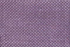 Violet textile background with checkered pattern, closeup. Structure of the fabric macro. Stock Photography