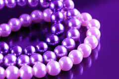 Violet tinted pearls Stock Photography