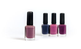 Violet tone nailpolishes Stock Photos