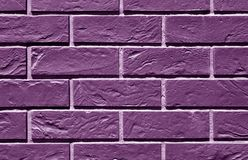 violet toned brick wall pattern. Stock Photos