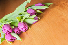 Violet tulips on the table Royalty Free Stock Photos