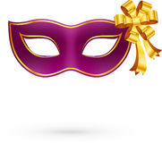 Violet vector carnival mask with golden bow Stock Image