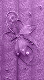 Violet vertical handmade greeting decoration with shiny beads, embroidery, silver thread in form of flower and butterfly Stock Photography