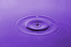 Violet water drop Stock Photo