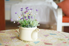 Violet and white artificial flowers Stock Image