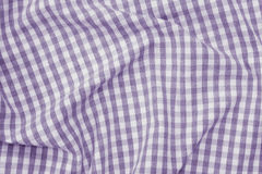 Violet and white checkered fabric background texture. Violet and white color checkered fabric background texture Royalty Free Stock Image