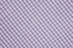 Violet and white checkered fabric background texture. Violet and white color checkered fabric background texture Royalty Free Stock Photo