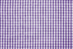 Violet and white checkered fabric background texture. Violet and white color checkered fabric background texture Stock Image