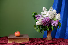 Violet and white lilacs in a vase of ceramics Royalty Free Stock Images