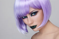 Violet wig and green make-up Royalty Free Stock Photos