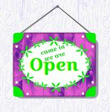 Violet wood and green flower hanging sign with text Come in, we re open . White border box. vector illustration royalty free illustration