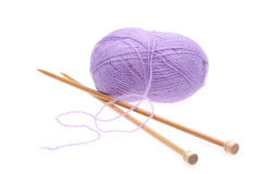 Violet woolen a thread with spokes for knitting. On a white background Stock Photography