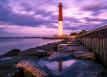 Violet World. Barnegat Lighthouse. Beautiful violet sunset at Barnegat Lighthouse State Park in New Jersey stock photography