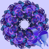 Violet wreath with painted peacock feathers, ribbon and bow. Stock Photography