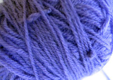 Violet yarn. A ball of acrylic yarn Royalty Free Stock Images