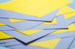 Violet and yellow color paper background closeup Stock Images