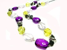 Violet and yellow jewellery beads Stock Photos