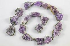 Violetkleurige brokkenspiraal Stock Afbeeldingen