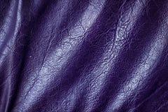 Violett lädermodellbakgrund Arkivfoto