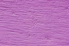 Violett texturerad murbrukyttersida för lilor eller arkivfoton