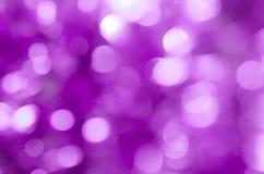 Violette bokeh steekt achtergrond aan Stock Afbeeldingen