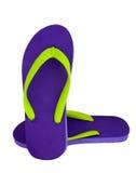 Violette Flipflops auf Weiß Stockbild