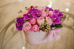 Violette pink palette rose mix flower  bouquet. On table Royalty Free Stock Photography