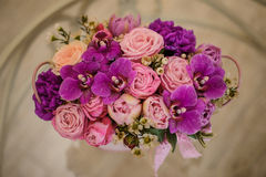 Violette pink palette rose mix flower  bouquet. On table Stock Photo