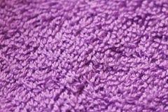 Violette textiel (stof) macromeningstextuur Stock Foto